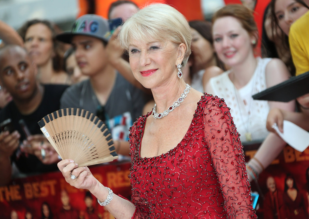 . Dame Helen Mirren fans herself in the heat as she arrives on the red carpet for the European Premiere of Red 2, at a central London cinema, Monday, July 22, 2013. (Photo by Joel Ryan/Invision/AP)