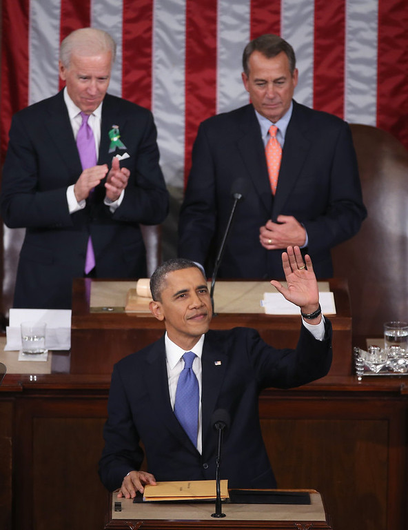 """. U.S. President Barack Obama delivers his State of the Union speech before a joint session of Congress at the U.S. Capitol February 12, 2013 in Washington, DC. Facing a divided Congress, Obama is expected to focus his speech on new initiatives designed to stimulate the U.S. economy and said, \""""It�s not a bigger government we need, but a smarter government that sets priorities and invests in broad-based growth\"""".  (Photo by Mark Wilson/Getty Images)"""