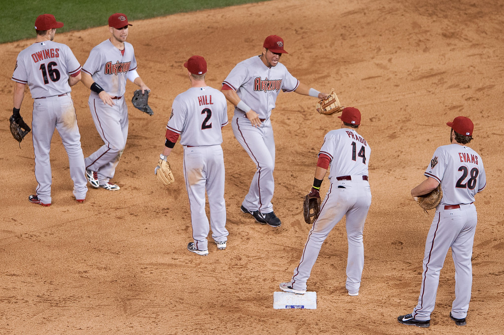 . Arizona Diamondbacks players, including David Peralta #6, center, celebrate the win over the Colorado Rockies at Coors Field on June 3, 2014 in Denver, Colorado.  The Diamondbacks beat the Rockies 4-2. (Photo by Dustin Bradford/Getty Images)