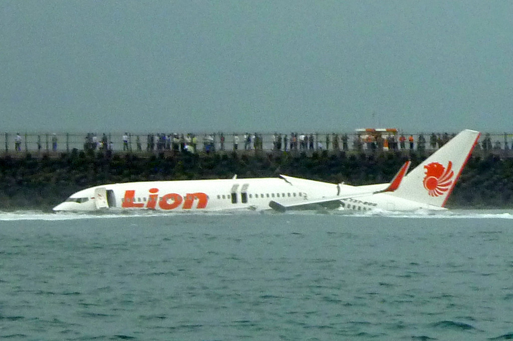 . A Lion Air Boeing 737 lies submerged in the water after skidding off the runaway during landing at Bali\'s international airport near Denpasar on April 13, 2013. An Indonesian plane carrying more than 100 passengers broke in two after missing the runway at Bali airport on April 13 and landing in the sea, leaving dozens injured but no fatalities. Karna Surya Putra/AFP/Getty Images