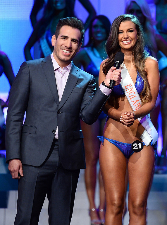 . Co-host and former mixed martial artist Kenny Florian (L) holds a microphone as Lydia Hipkiss of England answers a question during the interview portion of the 17th annual Hooters International Swimsuit Pageant at The Joint inside the Hard Rock Hotel & Casino on June 27, 2013 in Las Vegas, Nevada. Hipkiss went on to be named the second runner-up.  (Photo by Ethan Miller/Getty Images)