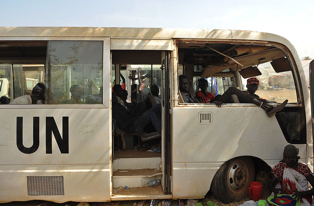 . Young South Sudanese men sit in a disused UN vehicle at the United Nations Mission in South Sudan (UNMISS) compound in Juba on December 21, 2013 as tension remains high fueling an exodus of both local and foreign residents from the south Sudanese capital. Brutal fighting in South Sudan has reopened deep-rooted ethnic divisions, forcing tens of thousands of terrified residents to seek shelter at UN bases or flee in fear of attacks. United Nations peacekeepers are currently sheltering over 35,000 civilians in various bases across the country, many belonging to the minority ethnic group in their respective areas.  TONY KARUMBA/AFP/Getty Images