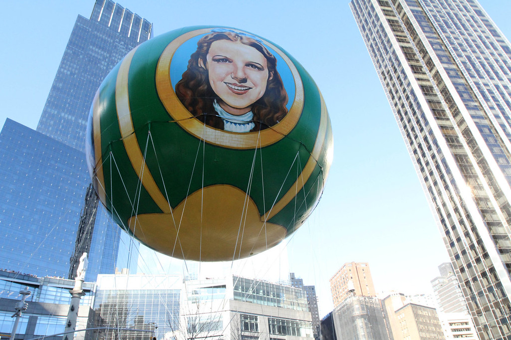 . The Wizard of Oz balloon makes it way through New York\'s Columbus Circle during the Macy\'s Thanksgiving Day Parade Thursday Nov. 28, 2013 in New York. After fears the balloons could be grounded if sustained winds exceeded 23 mph, the balloons received the all-clear from the New York Police Department to fly between Manhattan skyscrapers on Thursday. (AP Photo/Tina Fineberg)