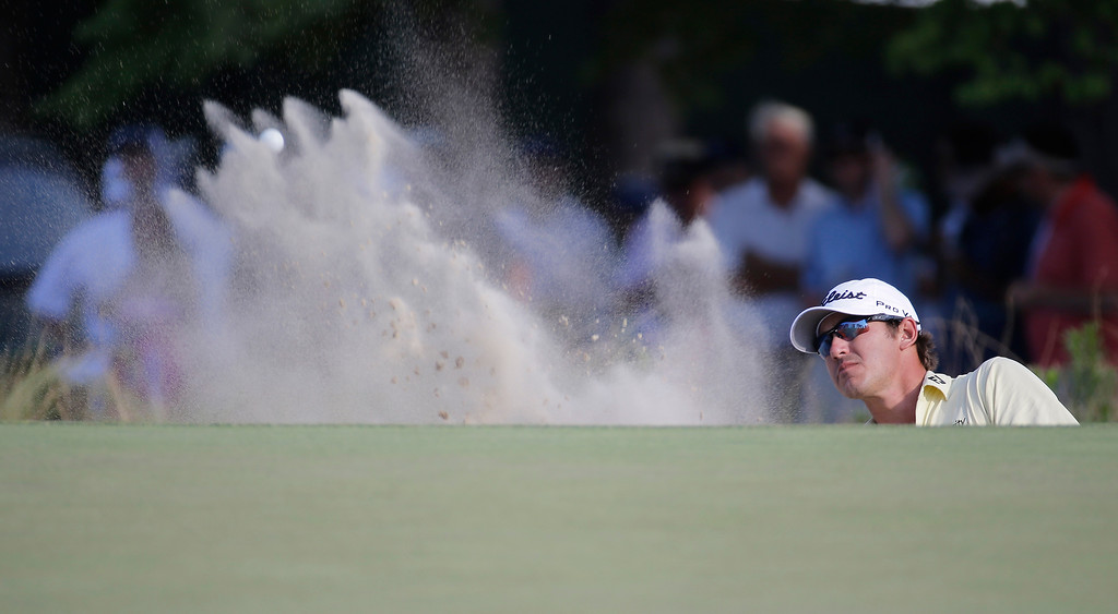 . Brooks Koepkahits out of the bunker on the 13th hole during the final round of the U.S. Open golf tournament in Pinehurst, N.C., Sunday, June 15, 2014. (AP Photo/Eric Gay)