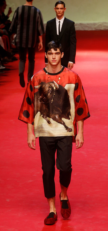 . A model wears a creation for Dolce & Gabbana men\'s Spring-Summer 2015 collection, part of the Milan Fashion Week, unveiled in Milan, Italy, Saturday, June 21, 2014. (AP Photo/Luca Bruno)