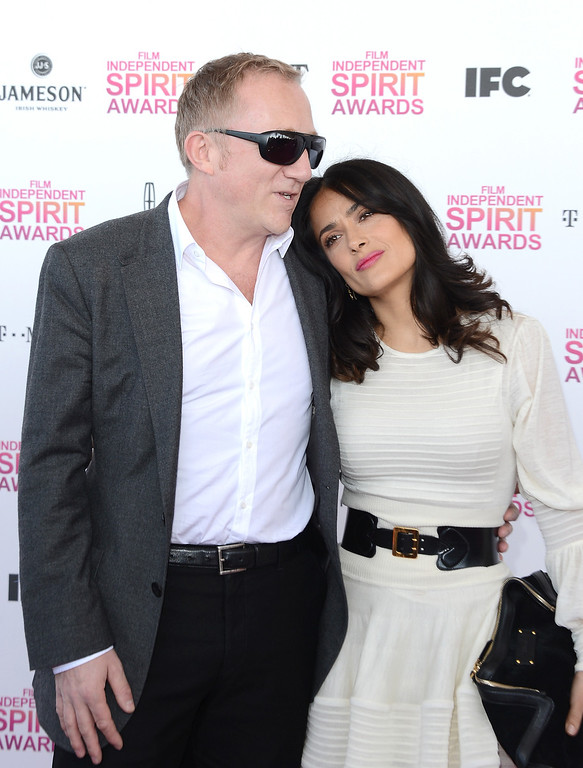 . SANTA MONICA, CA - FEBRUARY 23:  Actress Salma Hayek (R) and Francois-Henri Pinault attend the 2013 Film Independent Spirit Awards at Santa Monica Beach on February 23, 2013 in Santa Monica, California. (Photo by Jason Merritt/Getty Images)