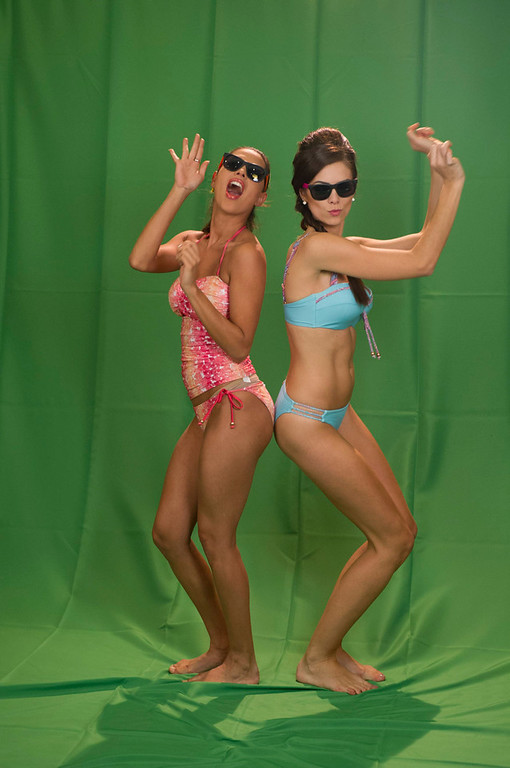 . Miss Bolivia Yessica Mouton and Miss Brazil Gabriela Markus (R) wear swimwear as part of a filming green screen segment at Planet Hollywood Resort and Casino in Las Vegas, Nevada December 9, 2012. The contestants are filming segments around Las Vegas to air as part of the live NBC Telecast of the 2012 Miss Universe Pageant set for December 19. REUTERS/Darren Decker/Miss Universe Organization L.P./Handout