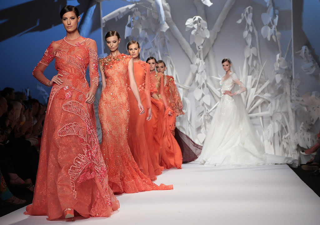 . Models walk the runway during Abed Mahfouz F/W 2013-2014 Haute Couture collection fashion show as part of AltaRoma AltaModa Fashion Week at Santo Spirito In Sassia on July 9, 2013 in Rome, Italy.  (Photo by Elisabetta Villa/Getty Images)