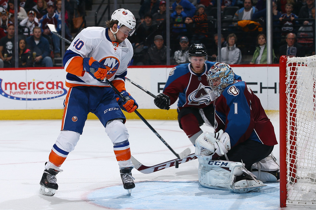 . DENVER, CO - JANUARY 10:  Michael Grabner #40 of the New York Islanders has a shot saved by goalie Semyon Varlamov #1 of the Colorado Avalanche before Grabner collected the rebound and scored the game winning goal in overtime at Pepsi Center on January 10, 2014 in Denver, Colorado. The Islanders defeated the Avalanche 2-1 in overtime.  (Photo by Doug Pensinger/Getty Images)