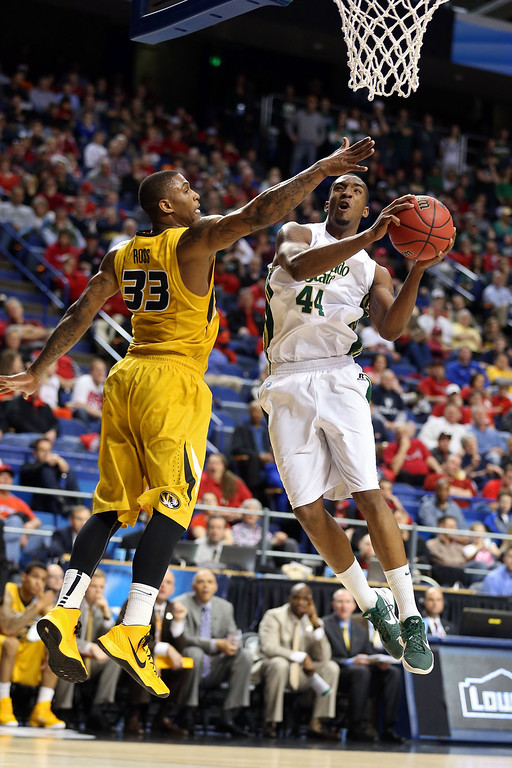 . LEXINGTON, KY - MARCH 21:  Greg Smith #44 of the Colorado State Rams goes to the hoop against Earnest Ross #33 of the Missouri Tigers during the second round of the 2013 NCAA Men\'s Basketball Tournament at the Rupp Arena on March 21, 2013 in Lexington, Kentucky.  (Photo by Andy Lyons/Getty Images)