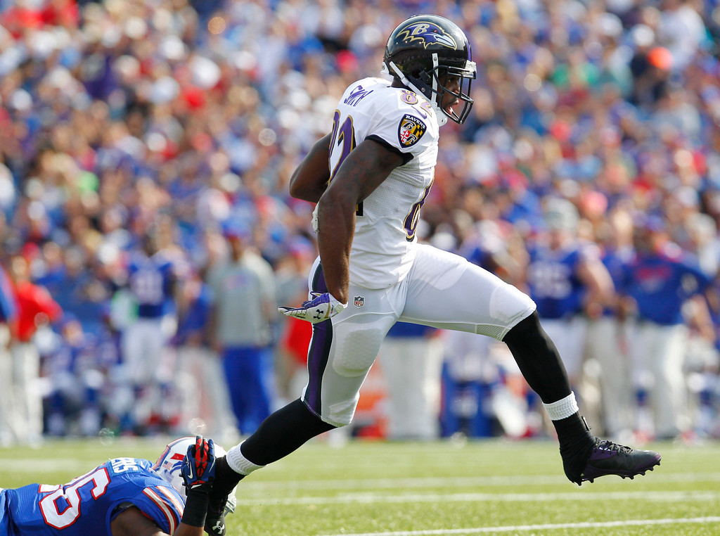 . Baltimore Ravens wide receiver Torrey Smith (82) scores a touchdown in front of a Buffalo Bills defender during the second half of an NFL football game on Sunday, Sept. 29, 2013, in Orchard Park, N.Y. (AP Photo/Bill Wippert)