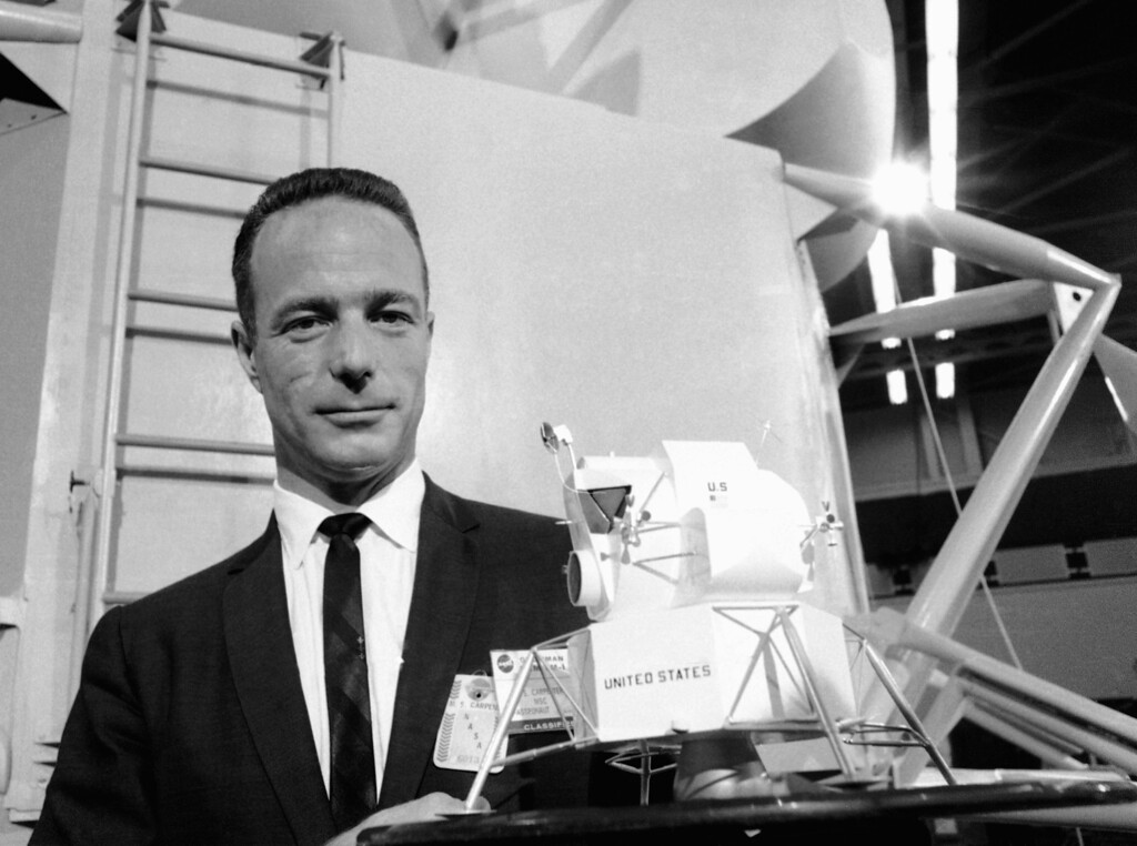 . In this March 26, 1967 file photo, astronaut Scott Carpenter poses with model of the Lunar Excursion Module (LEM) at Grumman Aircraft Engineering Corp. plant in Bethpage, N.Y. Carpenter, the second American to orbit the Earth and first person to explore both the heights of space and depths of the ocean, died Thursday, Oct. 10, 2013 after a stroke. He was 88. (AP Photo/Camerano)