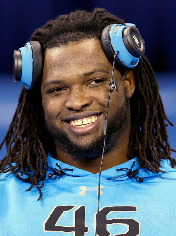 . Alabama defensive lineman Ed Stinson smiles as he looks to the field at the NFL football scouting combine in Indianapolis, Monday, Feb. 24, 2014. (AP Photo/Nam Y. Huh)