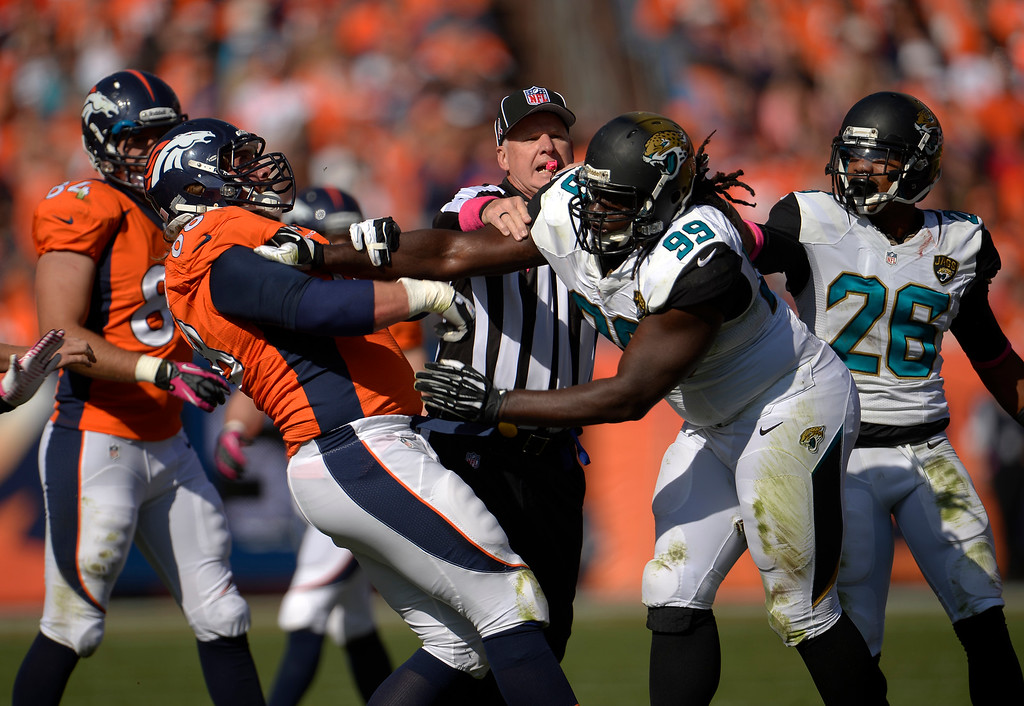 . Denver Broncos guard Zane Beadles (68) and Jacksonville Jaguars defensive tackle Sen\'Derrick Marks (99) get into a pushing match in the first quarter.  (Photo by Joe Amon/The Denver Post)