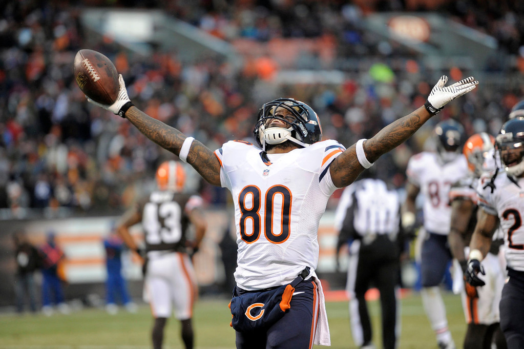 . Chicago Bears wide receiver Earl Bennett celebrates after catching a four-yard touchdown pass against the Cleveland Browns in the fourth quarter of an NFL football game Sunday, Dec. 15, 2013, in Cleveland. (AP Photo/David Richard)