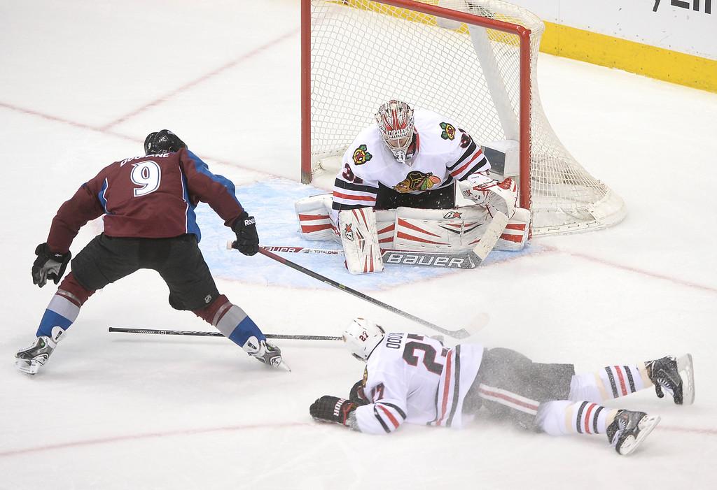 . Colorado center Matt Duchene (9) skated past Chicago defenseman Johnny Oduya (27) in the second period.  (Photo by Karl Gehring/The Denver Post)