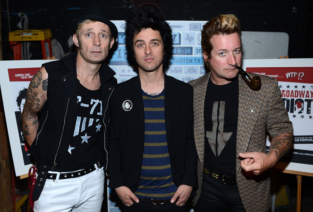 """. (L-R) Mike Dirnt, Billie Joe Armstrong and Tre Cool of Green Day pose backstage for a picture before the World Premiere of \""""Broadway Idiot\"""" during the 2013 SXSW Music, Film + Interactive Festival at the Paramount Theatre on March 15, 2013 in Austin, Texas."""