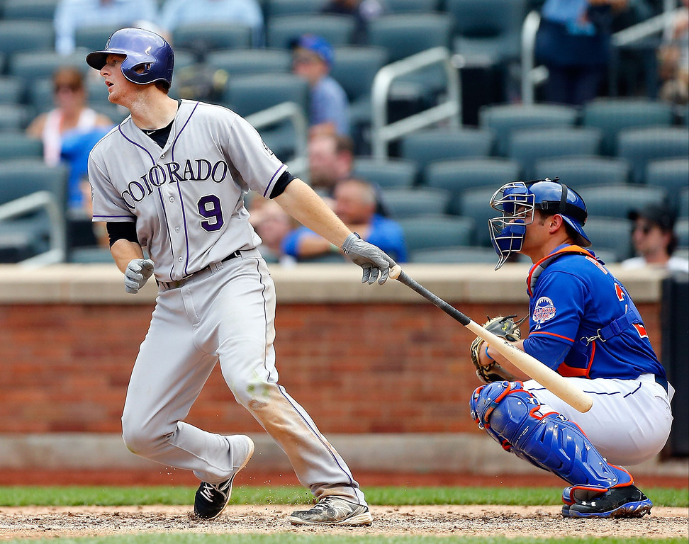 . DJ LeMahieu #9 of the Colorado Rockies follows through on a sixth inning base hit against the New York Mets at Citi Field on August 8, 2013 in the Flushing neighborhood of the Queens borough of New York City. The Mets defeated the Rockies 2-1.  (Photo by Jim McIsaac/Getty Images)