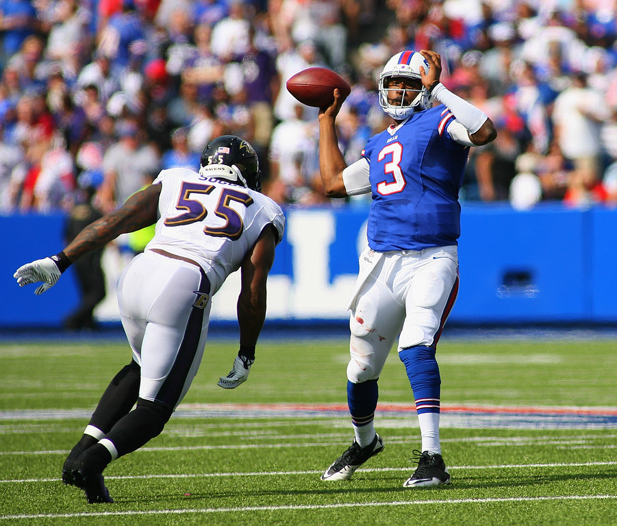 . ORCHARD PARK, NY - SEPTEMBER 29:   EJ Manuel #3 of the Buffalo Bills throws against Terrell Suggs #55 of the Baltimore Ravens at Ralph Wilson Stadium on September 29, 2013 in Orchard Park, New York.  (Photo by Rick Stewart/Getty Images)