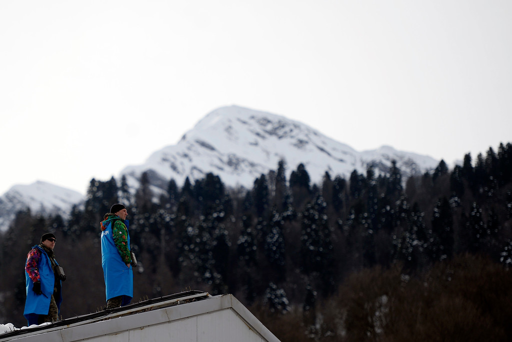 . SOCHI, RUSSIA - FEBRUARY 09: Officials patrol the perimeter of the venue during the alpine skiing men\'s downhill final. Sochi 2014 Winter Olympics at the Rosa Khutor Alpine Resort on Sunday, February 9, 2014. (Photo by AAron Ontiveroz/The Denver Post)