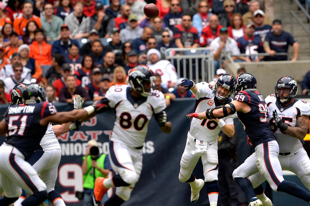 . HOUSTON, TX. - December 22: Quarterback Peyton Manning #18 of the Denver Broncos get off a pass over the Houston Texans at Reliant Stadium December 22, 2013 Houston, Texas. (Photo By Joe Amon/The Denver Post)