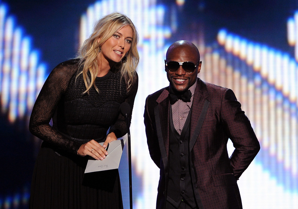 . LOS ANGELES, CA - JULY 16:  Tennis player Maria Sharapova and boxer Floyd Mayweather Jr. speak onstage during the 2014 ESPYS at Nokia Theatre L.A. Live on July 16, 2014 in Los Angeles, California.  (Photo by Kevin Winter/Getty Images)