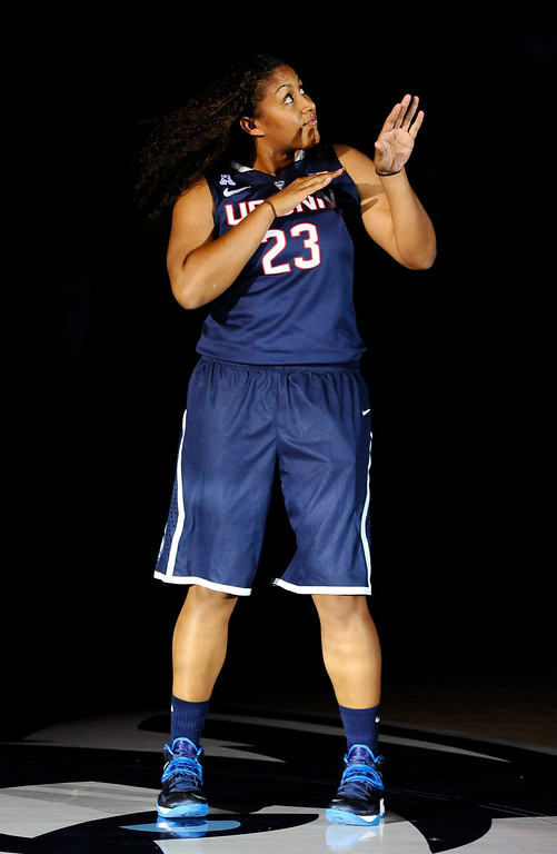 . Connecticut\'s Kaleena Mosqueda-Lewis dances as she is introduced at the men\'s and women\'s basketball teams\' First Night event, Friday, Oct. 18, 2013, in Storrs, Conn. (AP Photo/Jessica Hill)