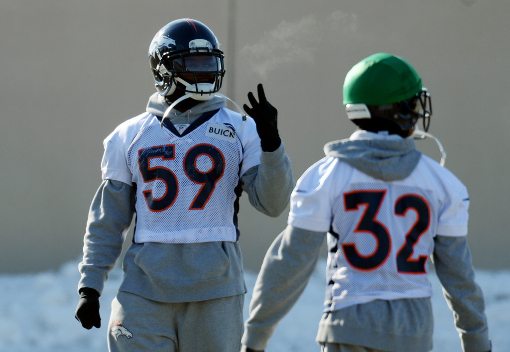 . Danny Trevathan (59), left, and Tony Carter (32) of Denver Broncos are warming up for the practice at Denver Broncos Headquarters at Dove Valley in Englewood, Colorado on Friday,  December 6, 2013. (Photo by Hyoung Chang/The Denver Post)
