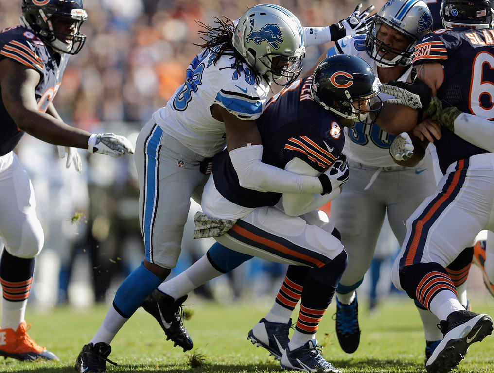 . Chicago Bears quarterback Jay Cutler (6) gets sacked by Detroit Lions defensive end Willie Young (79) during the first half of an NFL football game, Sunday, Nov. 10, 2013, in Chicago. (AP Photo/Nam Y. Huh)