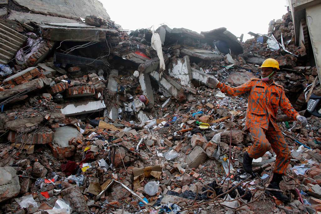 . A rescue worker attempts to find survivors from the rubble of the collapsed Rana Plaza building in Savar, 30 km (19 miles) outside Dhaka April 30, 2013. At least 390 people have been confirmed dead in what is just the latest incident to raise serious questions about worker safety and low wages in the poor South Asian country that relies on garments for 80 percent of its exports. REUTERS/Khurshed Rinku