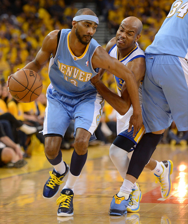 . Corey Brewer (13) of the Denver Nuggets works around a pick by JaVale McGee (34) as Jarrett Jack (2) of the Golden State Warriors fights through it during the second quarter in Game 6 of the first round NBA Playoffs May 2, 2013 at Oracle Arena. (Photo By John Leyba/The Denver Post)