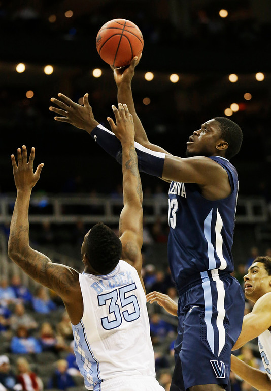 . Villanova forward Mouphtaou Yarou (13) shoots over North Carolina guard/forward Reggie Bullock (35) during the first half of a second-round game in the NCAA college basketball tournament at the Sprint Center in Kansas City, Mo., Friday, March 22, 2013. (AP Photo/Orlin Wagner)