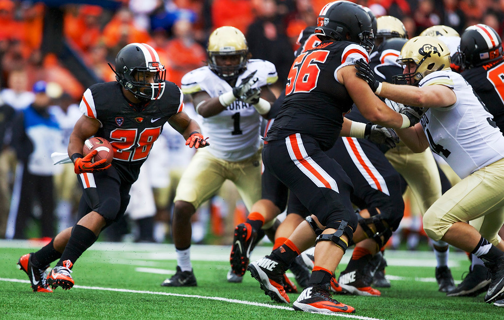 . Oregon State Beavers running back Terron Ward (28) carries the ball in the first half against the Colorado Buffaloes at Reser Stadium in Corvallis Saturday.  Photo by Randy L. Rasmussen/The Oregonian