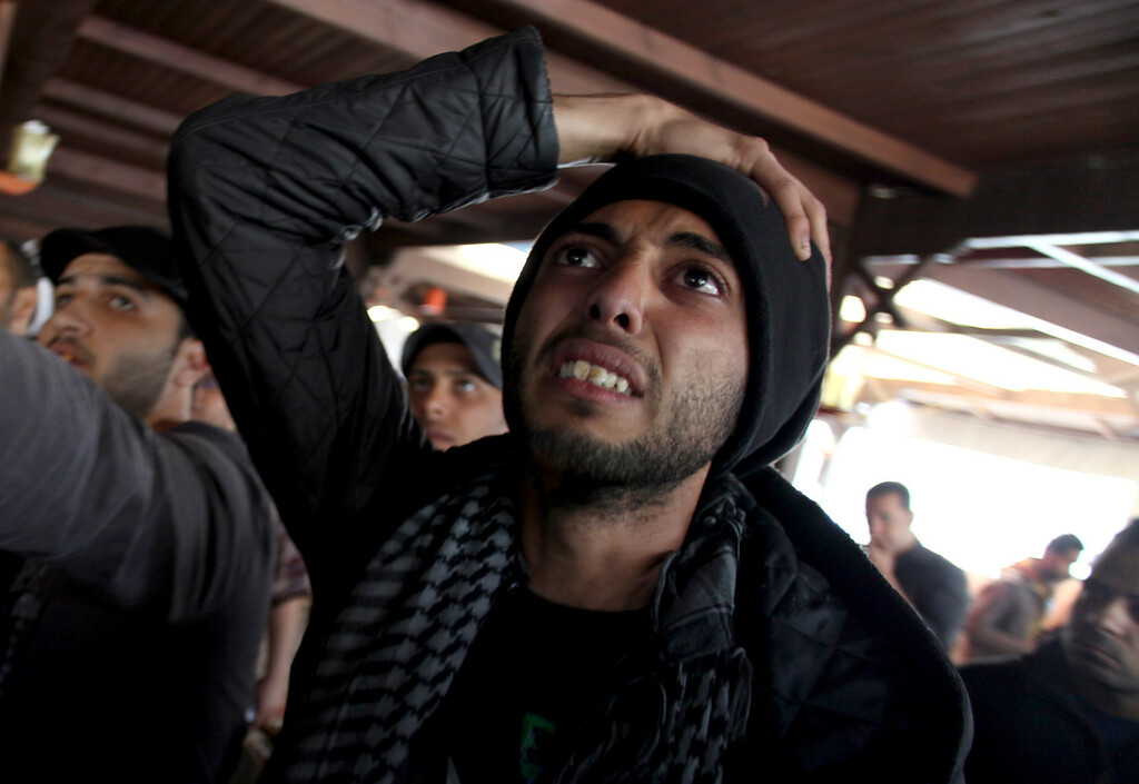 . An Egyptian man reacts as he watches a televised court verdict confirming death sentences against 21 people for their role in a deadly 2012 soccer riot, in a coffee shop in Port Said, Egypt, Saturday, March 9, 2013. (AP Photo/Khalil Hamra)