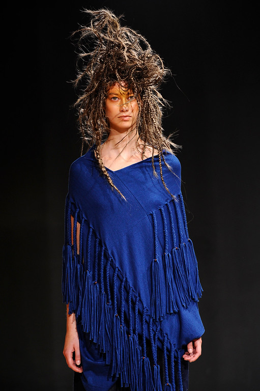 . A model presents a creation as part of Junya Watanabe\'s ready-to-wear Spring/Summer 2014 fashion collection, presented Saturday, Sept. 28, 2013 in Paris. (AP Photo/Zacharie Scheurer)