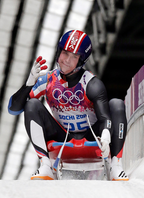. Tucker West of the United States smiles after finishing his final run during the men\'s singles luge final at the 2014 Winter Olympics, Sunday, Feb. 9, 2014, in Krasnaya Polyana, Russia. (AP Photo/Michael Sohn)