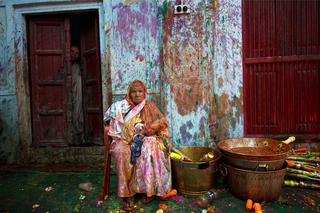 . An Indian widow rests celebrating Holi with water and gulal (colored powder) in Vrindavan on March 14, 2014. AFP PHOTO/Prakash SINGH/AFP/Getty Images