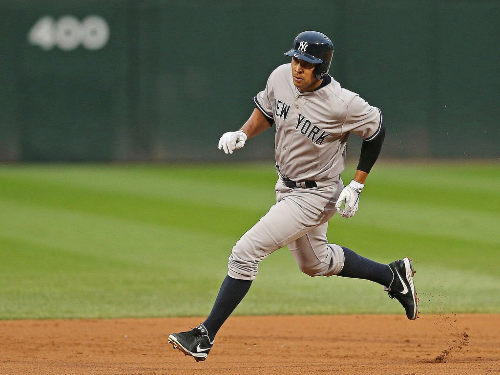. Alex Rodriguez #13 of the New York Yankees runs between first and third base on a hit by Vernon Wells during a game against the Chicago White Sox at U.S. Cellular Field on August 5, 2013 in Chicago, Illinois.  (Photo by Jonathan Daniel/Getty Images)