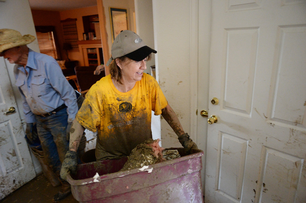. LONGMONT, CO - September 15 : Debbie Smith is moving the debris out from the basement of Stan McDonald\'s house damaged by flooding near the corner of Widgeon Dr. and Allen Drive. Longmont, Colorado. September 15, 2013. (Photo by Hyoung Chang/The Denver Post)