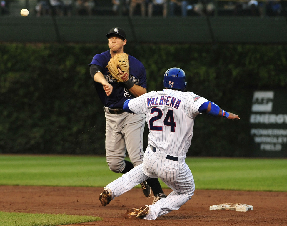 . CHICAGO, IL - JULY 30:  DJ LeMahieu #9 of the Colorado Rockies forces out Luis Valbuena #24 of the Chicago Cubs during the second inning on July 30, 2014 at Wrigley Field in Chicago, Illinois. (Photo by David Banks/Getty Images)