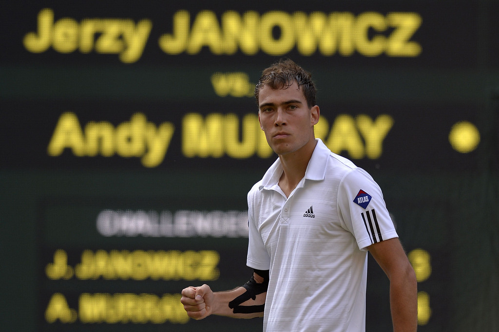 . Poland\'s Jerzy Janowicz celebrates winning the first set against Britain\'s Andy Murray in their men\'s singles semi-final match on day eleven of the 2013 Wimbledon Championships tennis tournament at the All England Club in Wimbledon, southwest London, on July 5, 2013. ADRIAN DENNIS/AFP/Getty Images