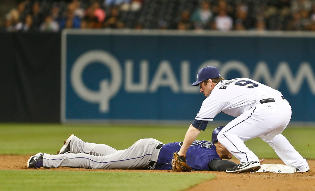 . San Diego Padres second baseman Jedd Gyorko puts a late tag to Colorado Rockies\' Nolan Arenado after Arenado over ran the base during action from the third inning of a baseball game Monday April 14, 2014, in San Diego. (AP Photo/Lenny Ignelzi)