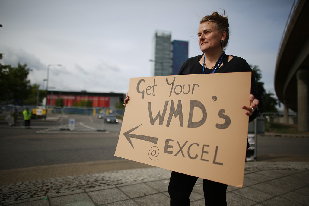 . A peace protestor stands outside the Defense and Security Exhibition on September 10, 2013 in London, England.  (Photo by Peter Macdiarmid/Getty Images)