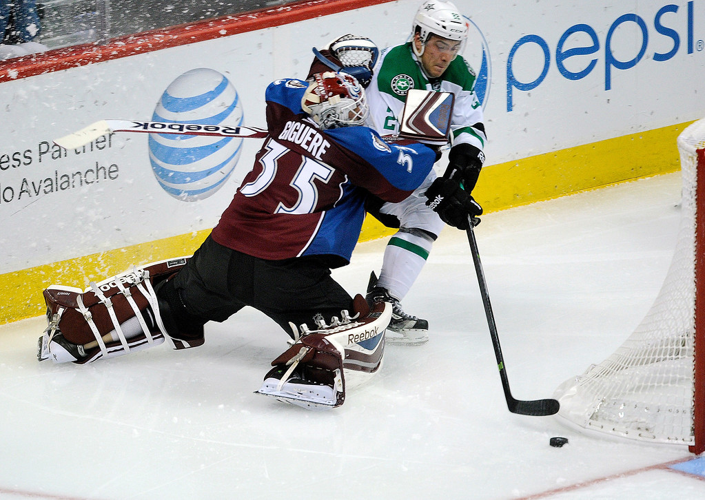 . Colorado goaltender J.S. Giguere (35) tried to slow down Dallas center Colton Sceviour (22) behind his net in the second period  Photo By Karl Gehring/The Denver Post