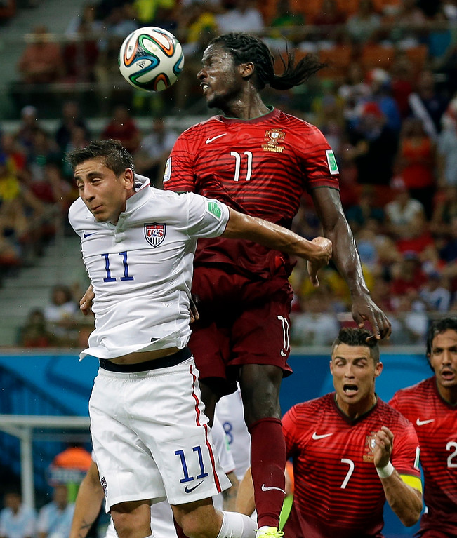 . Portugal\'s Eder heads the ball over United States\' Alejandro Bedoya during the group G World Cup soccer match between the USA and Portugal at the Arena da Amazonia in Manaus, Brazil, Sunday, June 22, 2014. (AP Photo/Martin Mejia)