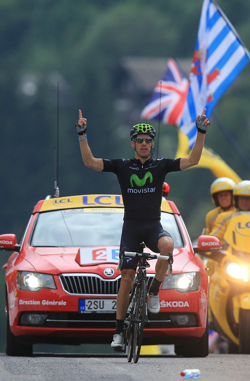 . Rui Costa of Portugal and Movistar Team celebrates winning stage nineteen of the 2013 Tour de France, a 204.5KM road stage from Bourg d\'Oisans to Le Grand Bornand, on July 19, 2013 in Le Grand Bornand, France.  (Photo by Doug Pensinger/Getty Images)