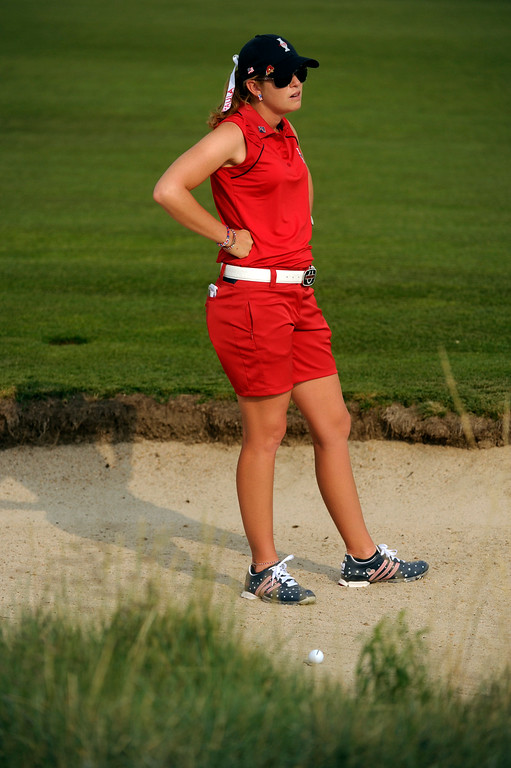 . PARKER, CO. - AUGUST 17: American golfer Paula Creamer contemplated a shot out of a bunker on the 16th hole Saturday at the Solheim Cup. It was the American Team versus the Europeans as play continued at the Colorado Golf Club Saturday afternoon, August 17, 2013. Photo By Karl Gehring/The Denver Post
