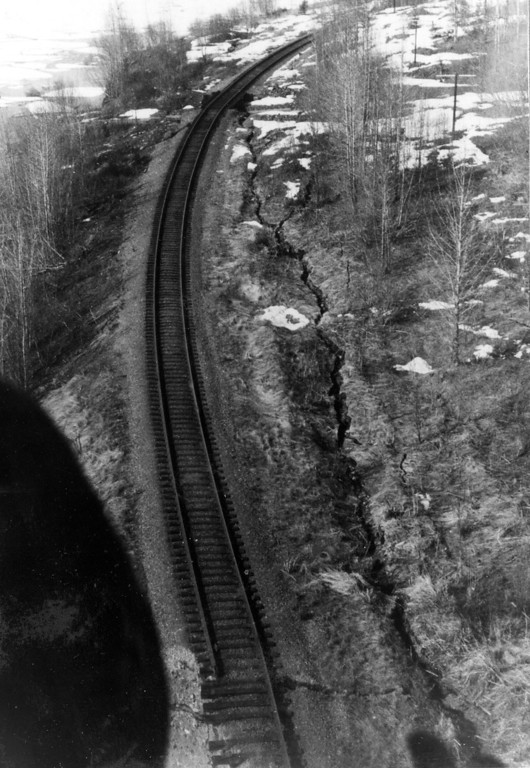 . Alaska Earthquake March 27, 1964. Ground fracture bounding the railroad line of Rocky Creek Delta just north of the slide that carried away part of the rail line. Photo by D.S. McCulloch, U.S. Geological Survey