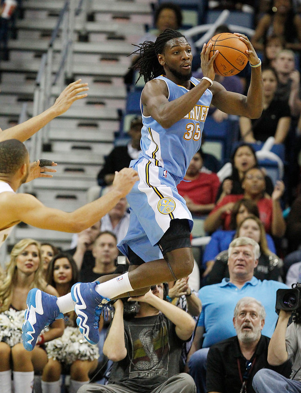 . Denver Nuggets power forward Kenneth Faried (35) passes the ball late in the second half against the New Orleans Plicans in an NBA basketball game in New Orleans, Sunday, March 9, 2014.Faried was high scorer for the Nuggets with 22-points.  The Pelicans defeated the Nuggets 111-107. (AP Photo/Bill Haber)