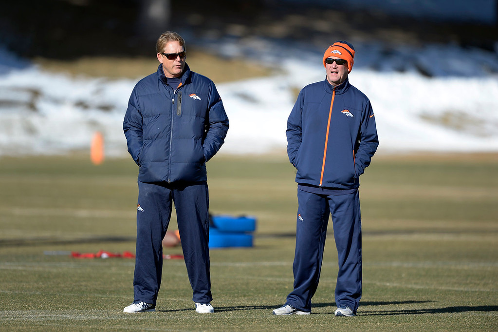 . Denver Broncos defensive coordinator Jack Del Rio talks with Denver Broncos head coach John Fox during practice January 2, 2014 at Dove Valley (Photo by John Leyba/The Denver Post)